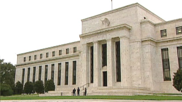Wall Street loses ground as Federal Reserve's statement on economy disappoints investors